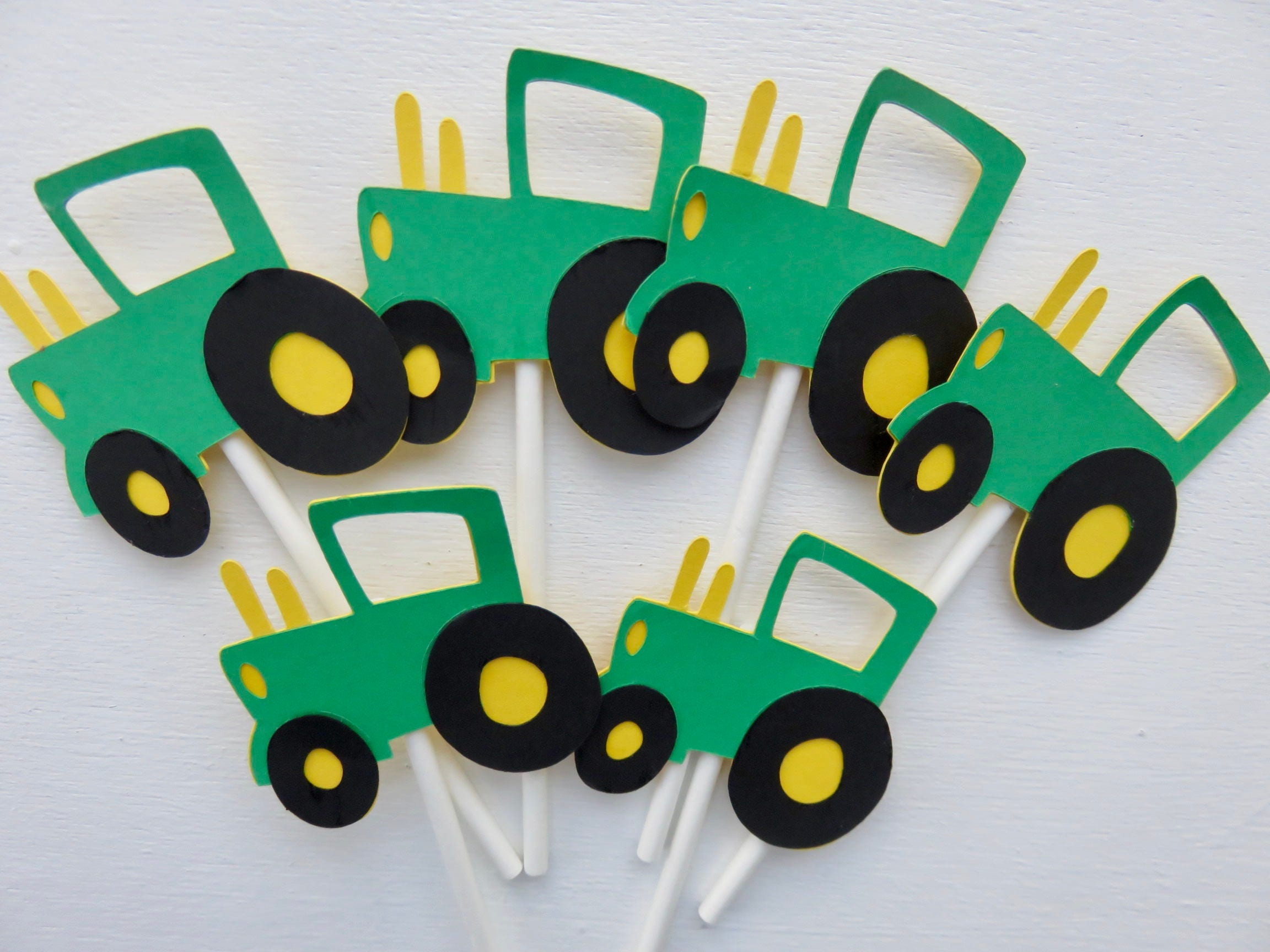 It is a photo of Wild John Deere Cupcake Toppers