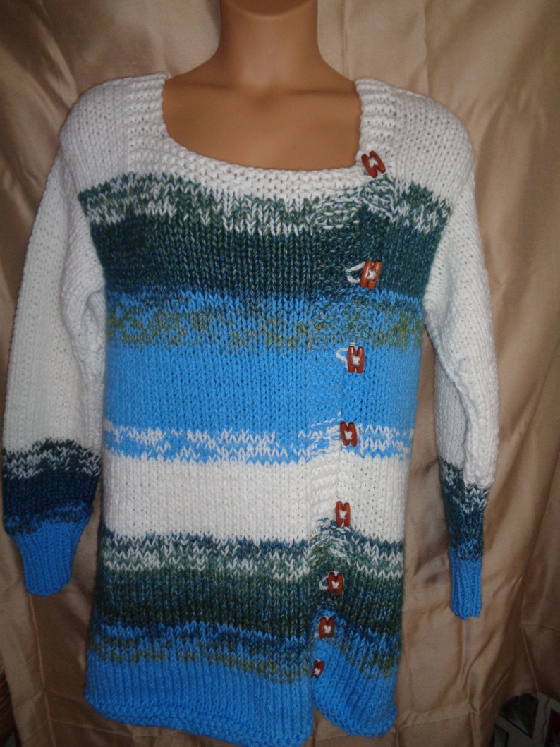 Sweater jacket in white bright summer sky blue and bluegreen variegated yarn Warm and comfy for outside. Size  1X 22-24