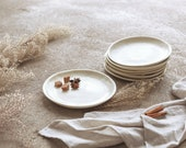 Modern pottery dessert plate is farmhouse table decor, cream color ceramic cake plate, off white stoneware pie dish, wedding plate