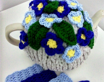 Knitted tea cosy , forget me not flowers