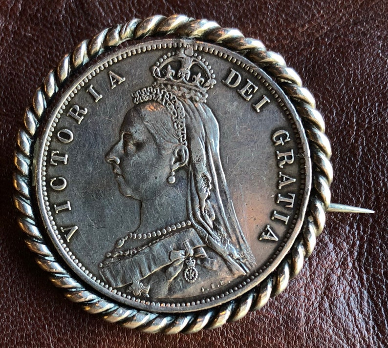 Vintage brooch made from a 1887  925 silver British half crown coin with  swirl mount