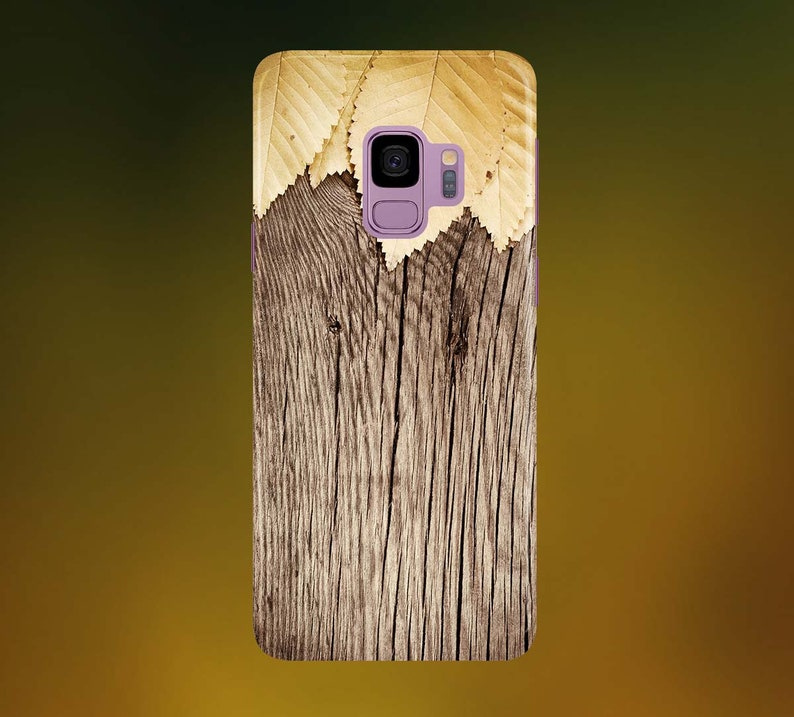 Gold Leaves on Dark Wood Phone Case for apple iphone samsung image 0