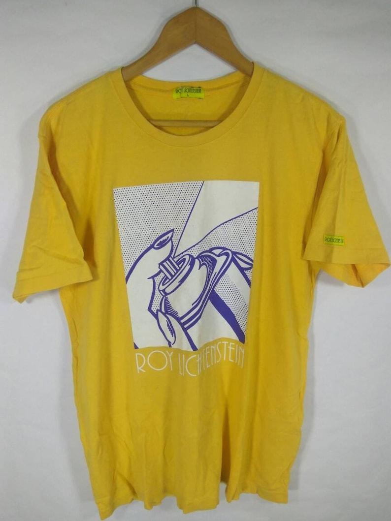 5f224687c6d38 90s Roy Lichtenstein Women Spraying Yellow T Shirt Pop Art Barbara Kruger  Andy Warhol Large size
