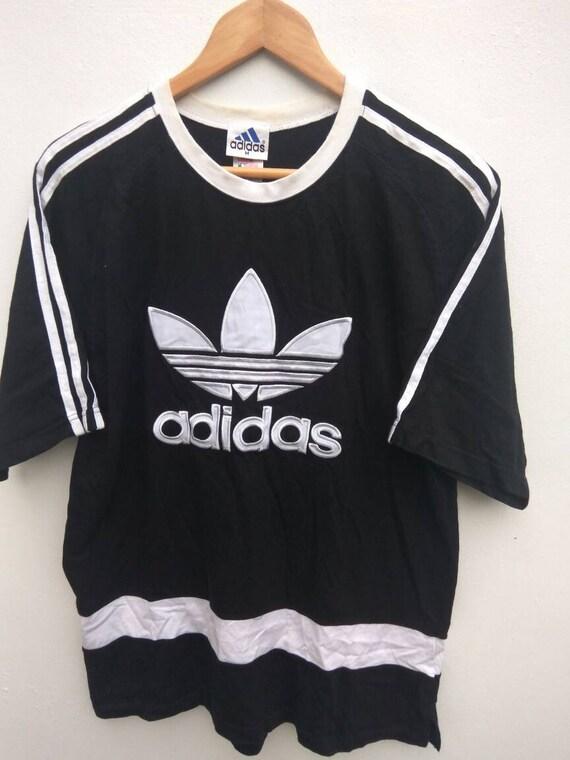 Vintage 90er Jahre ADIDAS Equipment ADIDAS Dreiblatt Adidas großes Logo schwarz mittlerer Größe