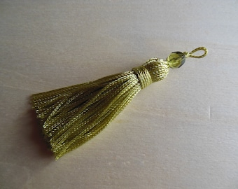 Tassel has fennel green bead
