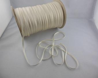 Woven off white or black ribbon