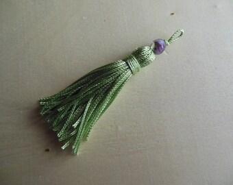 A green bead tassel