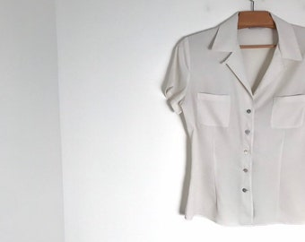 be878c1f65d CACHAREL vintage off white silky button down blouse with slim fit, short  sleeves and breast pockets / xs / 1980s