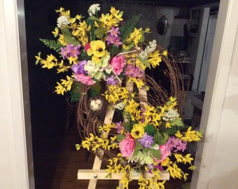 Spring grapevine wreath with bird nest