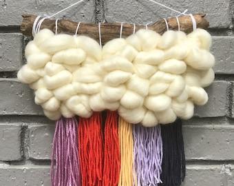 Handmade rainbow cloud weaving / woven wall hanging / textile art / wall art