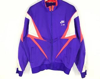 06ab7024c6ab8 Nike Multicolor vintage 90s track top jacket nike swoosh nike japan