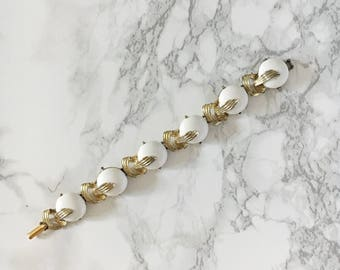 white enamel and gold bracelet