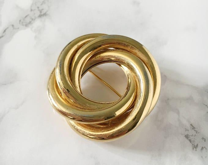 tri-swirl brooch