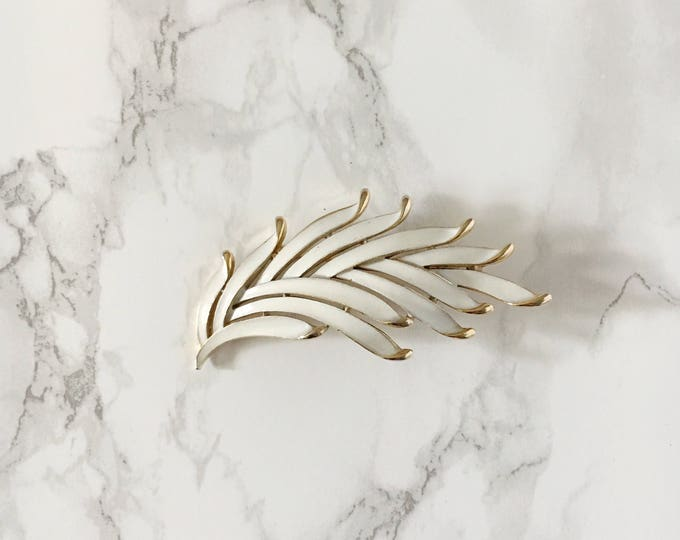 white-enamel leaf brooch