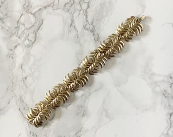 gold statement bracelet