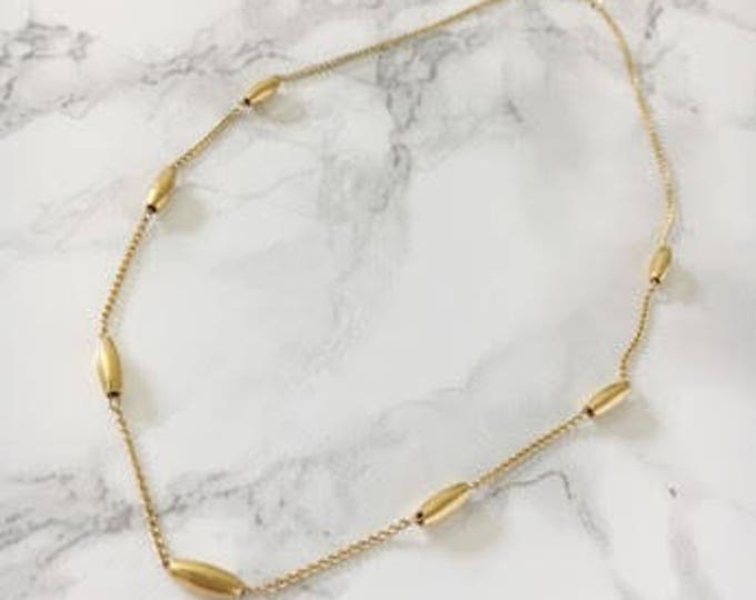 delicate oblong bead necklace
