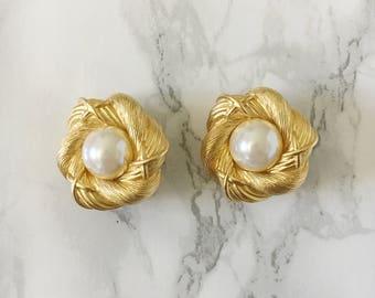 flower and pearl-center earrings