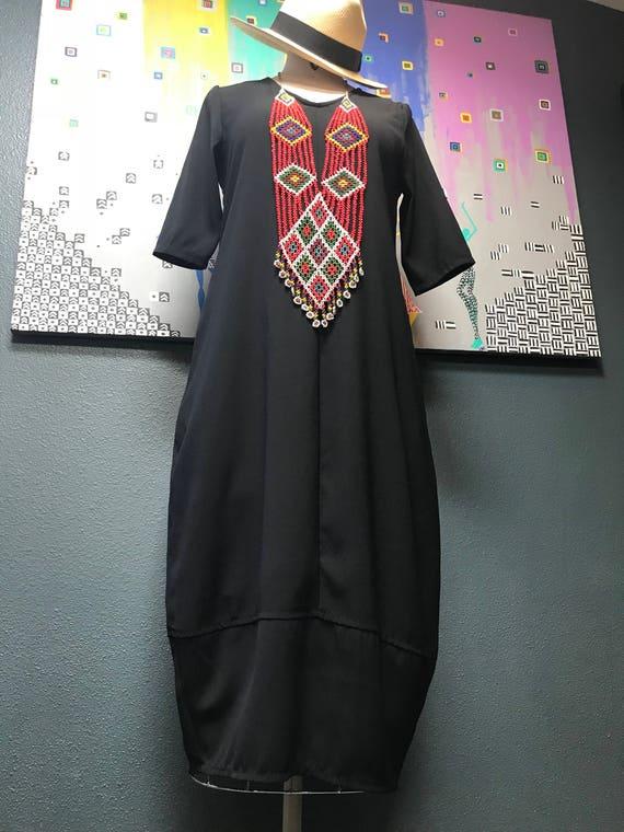 Modern black cocoon dress.