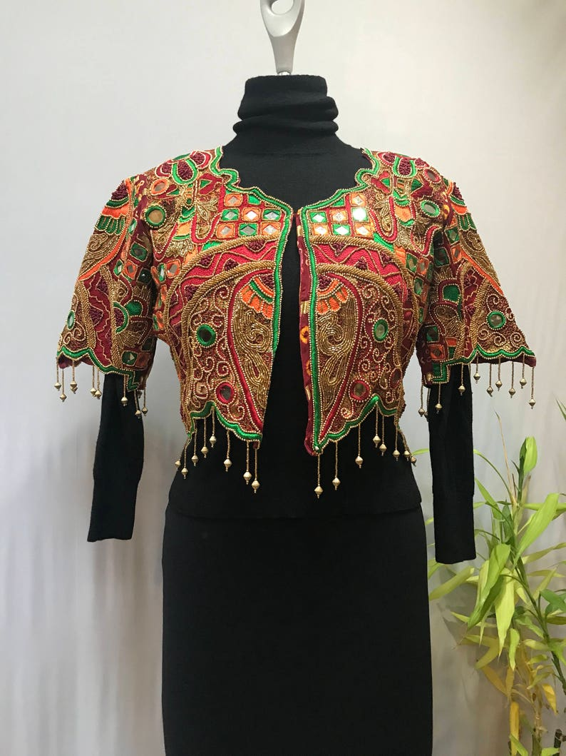 Stunning ornate vintage jacket reminds me of a butterfly.