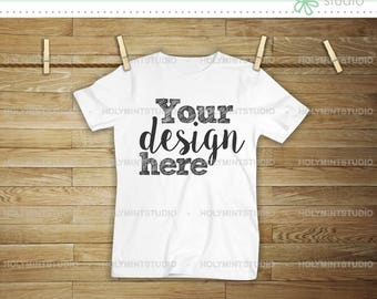 T-shirt template on wood background