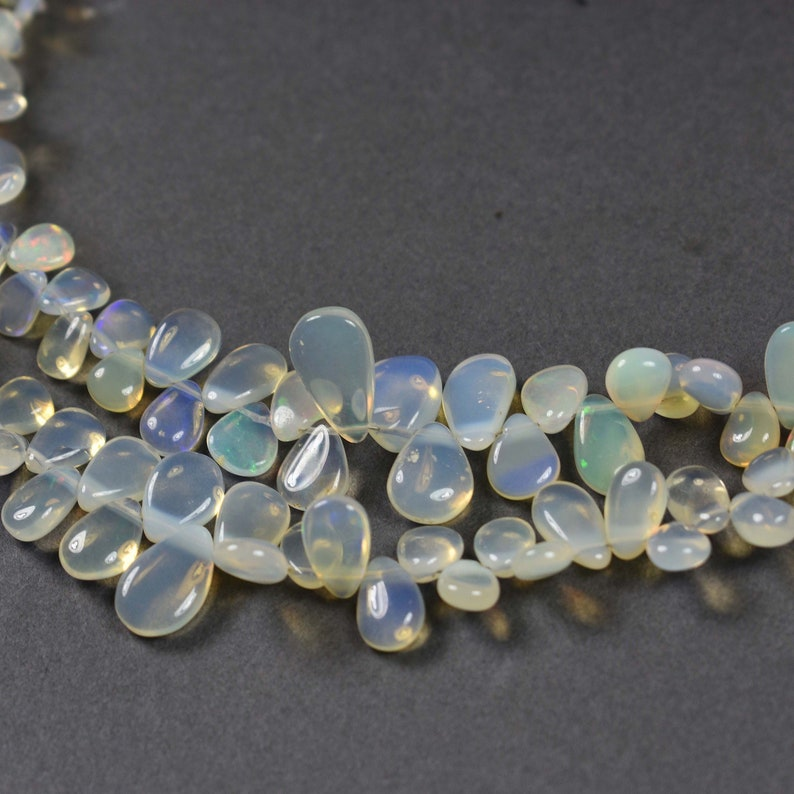 Beautiful~~~One Strand~~~Natural Ethiopian Welo Opal Pear Smooth Briolettes Beads~~14mmx8mm-7mmx5mm 9 Inch Strand