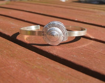 Sterling silver open bangle with Sundial shell