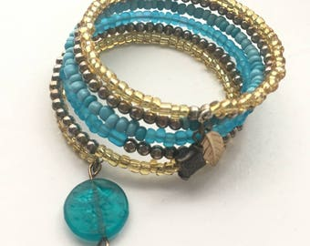 Turquoise and gold 6 wrap Memory Wire bracelet with 3 charms