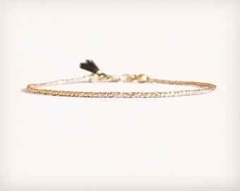 Dainty rose gold bracelet with tiny tassel