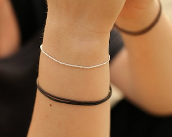 Dainty bracelet with tiny tassel, pure silver