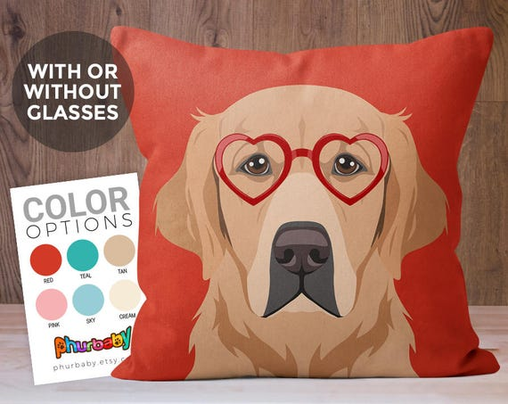 Red throw pillow with an image of a Golden Retriever on the front.