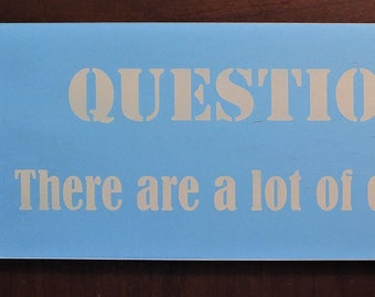 Question authority there are a lot of dumb asses running the show wooden sign