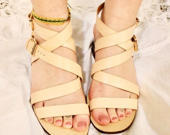f6f8e65c4636 Formal cream colored strappy buckled heeled sandles. Size 8 US womens shoes.