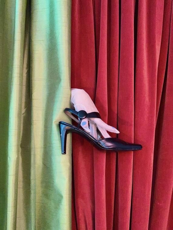 Strappy pointy asymmetrical heels