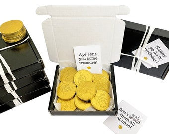 Tiny treats! Little Black box of Gold Pirate coins. Ideal for child gift/pirate party favours etc. Personalisable.