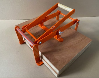 19 x 12,5 inch-size hand lino press, lino cut press, heavy duty, steel. Color: RAL 2004 orange