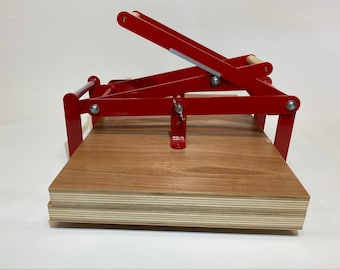 A2 size hand lino press, lino cut press, double lever operated, double US tabloid/ ledger size. Color: Ral 3000 red