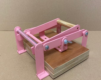 A5-size (junior legal+) hand lino press, lino cut press, heavy duty, steel, powdercoated pink (ral 3015)