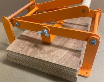 A4-size hand lino press, lino cut press, heavy duty, steel, US letter size, gloss orange powdercoated