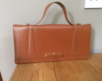 Vintage tan leather clutch/hand bag with purse and mirror.