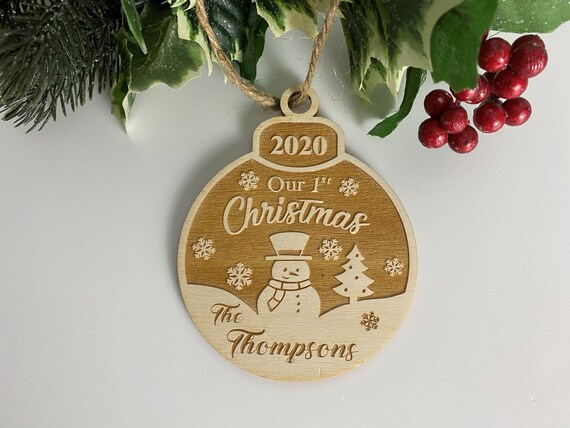 Laser Engraved Wood Ornament Personalized with The Family Last name and the established year