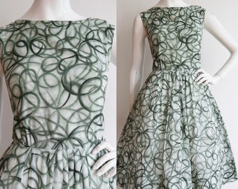 Vintage 1960s | Small | cotton batiste sundress with mid-century print.