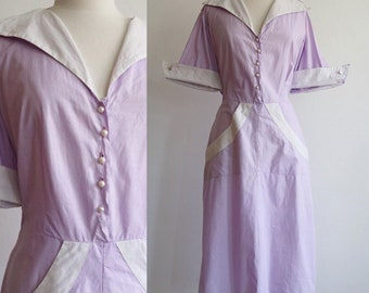 Vintage   XL   Volup 1940's cotton day dress with pointed collar and cuff, hip pockets and pearly buttons