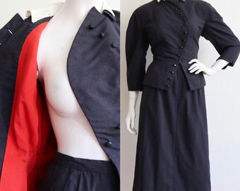 Vintage 1950s | Medium | Stunning fine wool skirt suit with asymmetrical front closure.