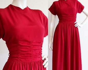 Vintage 1940s | Small | Carmine red cold rayon dress with shirred waist and fabric covered buttons.
