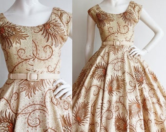 Vintage 1950s | Small | Breathtaking cotton sundress decorated with rhinestones and trapunto quilting, full circle skirt!