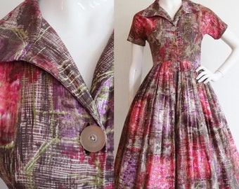 Vintage 1950s | Small | Abstract polished cotton dress with full skirt.