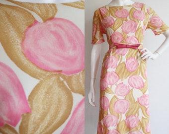 Vintage 1960s | Large | Floral jersey wiggle dress with decorative belt.
