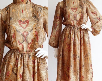 Vintage 1970s | M | Bold pattern polyester dress with metallic thread