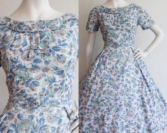 Vintage 1950s | Large | Blue floral cotton sundress.