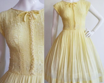 Vintage 1950s | Small | Daffodil yellow, cotton batiste sundress with smocked bodice by R&K Originals.